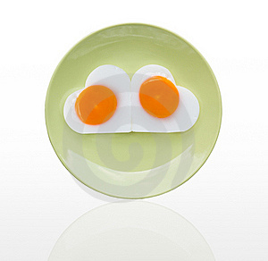 Fried Egg  Heart On Green Dish Royalty Free Stock Images - Image: 23006469