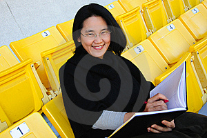 Young Asian College Student On Grandstand Stock Photos - Image: 23020143