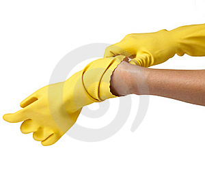 Female Putting On Yellow Gloves Royalty Free Stock Images - Image: 23054539