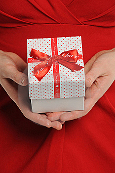 Woman Holding Gift Box With Ribbon Royalty Free Stock Photos - Image: 23061388
