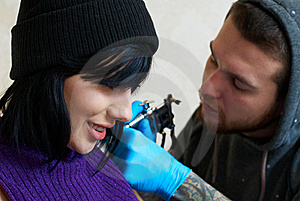 Emotions Of A Girl While Making A Tattoo Stock Photo - Image: 23071970