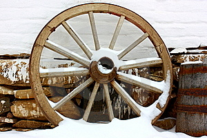 Antique Wagon Wheels In Snow Royalty Free Stock Images - Image: 23074169