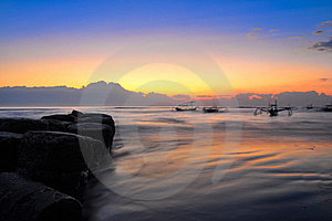 Ocean Coast Sunrise And Blury Boats Stock Photos - Image: 23076213