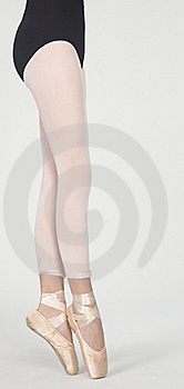 Ballerina's Legs On Pointe In White Tights Royalty Free Stock Photography - Image: 23097977