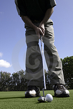 Golfer Sets Up For A Putt Royalty Free Stock Photo - Image: 23162955
