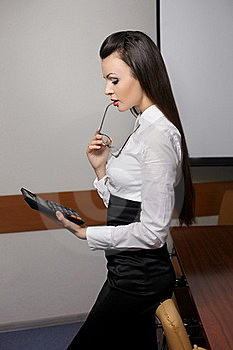Thinking Business Woman With Calculator In Office Stock Photo - Image: 23184930