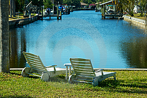 Two Empty Chairs By The Water Stock Photography - Image: 23270432