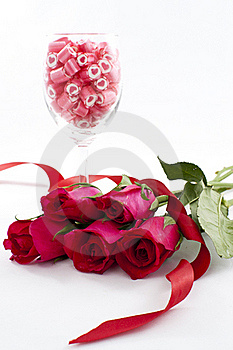 Candy In Wine Glass With Rose Royalty Free Stock Image - Image: 23288006