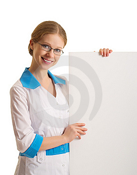 Female Doctor Holding A Blank Billboard Royalty Free Stock Image - Image: 23292016