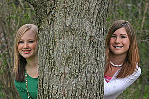 Girls Peeking Around A Tree Royalty Free Stock Photos - Image: 2331098