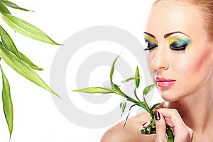 Beautiful Blonde With Bamboo Leaves Royalty Free Stock Photos - Image: 23311138