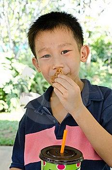 Asian Boy Eating Muffin Stock Photos - Image: 23323583