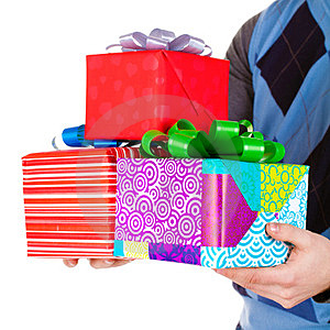 Present Gifts In Men's Hands Royalty Free Stock Photo - Image: 23331015