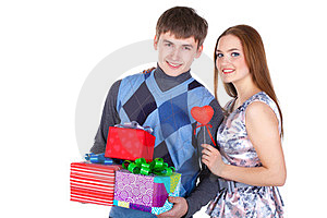 Young Couple With Gifts Royalty Free Stock Photos - Image: 23331068