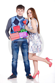 Young Couple With Gifts Royalty Free Stock Photos - Image: 23331088