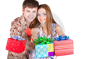 Young Couple With Gifts Stock Photos - Image: 23331113