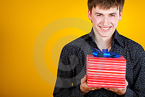 Present Gift Holding Man Looking Camera Royalty Free Stock Photography - Image: 23331207
