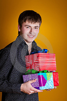 Present Gifts Holding Man Looking Camera Royalty Free Stock Photos - Image: 23331228