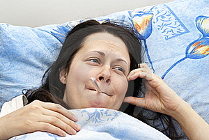 The Girl Was Lying In Bed And  The Temperature Royalty Free Stock Photography - Image: 23358947