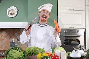 Funny Young Chef Preparing Lunch In Kitchen Stock Photos - Image: 23377323