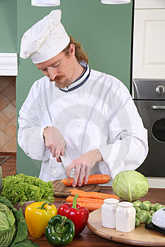 Young Chef Preparing Lunch In Kitchen Stock Photography - Image: 23377582