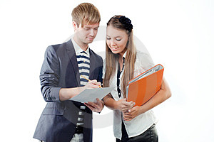 Young Man Explaining Something To Young Woman Royalty Free Stock Image - Image: 23387526