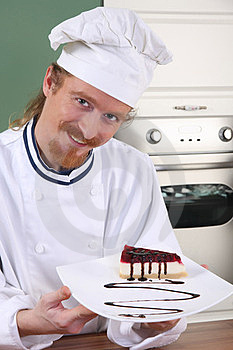Young Chef With Piece Of Cake Stock Image - Image: 23397851