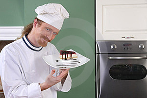 Young Chef With Piece Of Cake Stock Photos - Image: 23397883