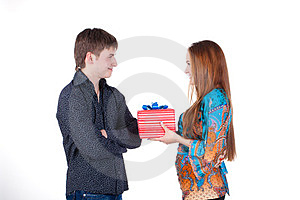 Young Couple With A Gift Isolated Stock Images - Image: 23429464