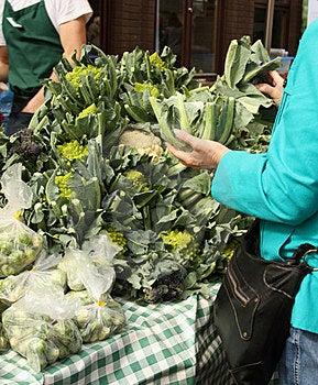 Mature Lady Holding Cauliflower Royalty Free Stock Image - Image: 23432756