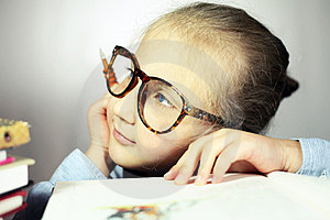 Girl With Big Glasses Thought Royalty Free Stock Photos - Image: 23463818