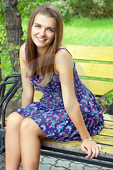 Girl Sitting On A Bench Stock Photography - Image: 23474202