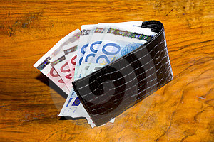 Euros In  Wallet, On Vintage Brown Backgroun Stock Photography - Image: 23478042