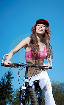 Woman On A Bicykle Outdoors Smiling Royalty Free Stock Photo - Image: 23479185
