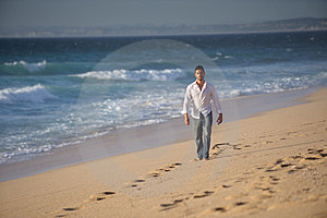 Man Walking Alone At The Beach Royalty Free Stock Image - Image: 23491666
