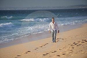 Man Walking Alone At The Beach Royalty Free Stock Image - Image: 23491666