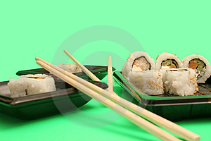 Chopsticks With Salmon Sushi R Royalty Free Stock Image - Image: 2350146