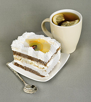Piece Of Cake With Fruit, Tea With , Spoon Royalty Free Stock Photography - Image: 23529867