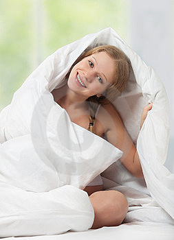 Funny Beautiful Girl Under The Blanket Royalty Free Stock Photo - Image: 23537245