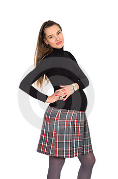 Nice Pregnant Girl In Plaid Skirt Stock Images - Image: 23564364