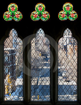 Three Tall Windows And Stained Glass Stock Images - Image: 23584084