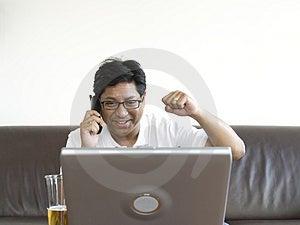 Asian man working on laptop Royalty Free Stock Photos