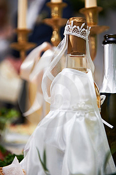 Bottle Of Champagne In Costumes Of Bride Stock Image - Image: 23612341