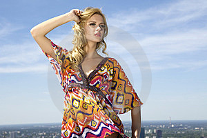 Beautiful girl on background blue sky Royalty Free Stock Photo