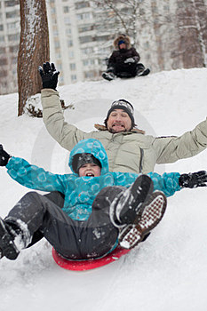Dad And Son Riding From Frozen Hill Stock Photos - Image: 23655573