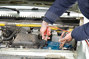 A Mechanic Using Jumper Cables Stock Image - Image: 23660321