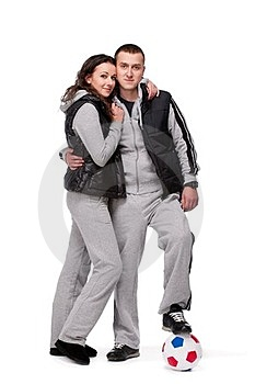 Young Sportive Couple With Soccer Ball Royalty Free Stock Photography - Image: 23687277