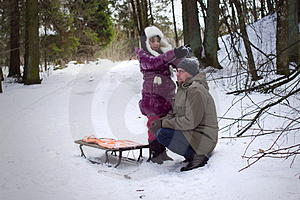 Daughter Playing With Father In Winter Royalty Free Stock Photos - Image: 23695048