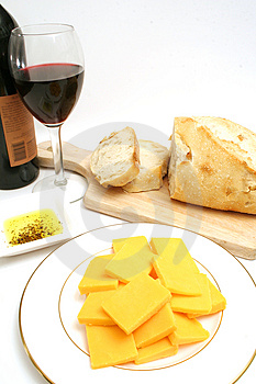 Wine and cheese on white