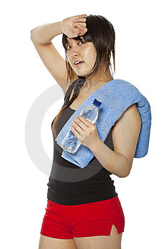 Asian Girl With Towel And Bottle Of Water Royalty Free Stock Photo - Image: 23705585